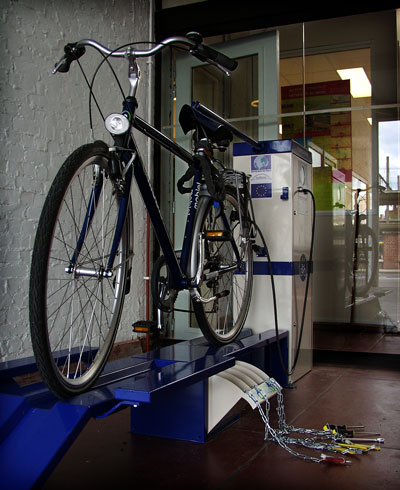 Electric bike connected to a charging station.