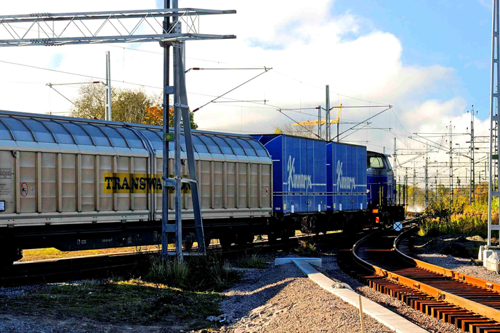 A cargo train moving ahead in sunny weather, carrying freight from the Port of Gothenburg.