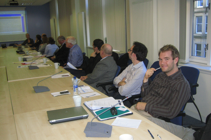 A man smiles at the camera at a meeting about greener ports and smart hubs.